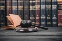 Judge Gavel and law book on a black wooden background. Stock Photos