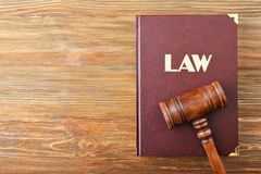 Judge gavel and Law book. On wooden background royalty free stock photo