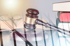 Law concept; multiple exposure. Judge gavel with law books; multiple exposure stock photos
