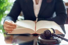 Judge gavel and lawyer reading law book. royalty free stock image