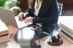 Judge gavel and lawyer working on a laptop in office royalty free stock photos