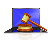 Judge Gavel Mallet on Laptop. A 3D illustration of cyber law depicted with a wooden judge's gavel or mallet and block, placed on a laptop computer. Ideal for use Stock Photos