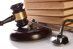 Judge gavel and medical stethoscope. Near law textbook in library archive study room, close-up. Forensic medicine investigation or malpractice justice concept Stock Photography