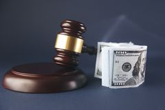 Judge gavel and money on brown wooden table concept. Judge gavel and money on brown wooden table stock photos