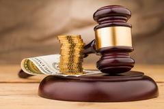 Judge gavel with money closeup Stock Photography