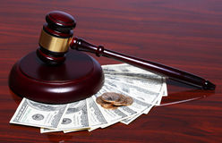 Judge Gavel and Money. Dollars Bills with Coins on Royalty Free Stock Photography