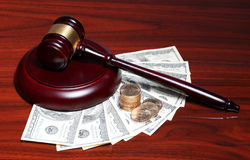 Judge Gavel and Money. Dollars Bills with Coins Stock Photo