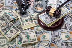Judge gavel with money and handcuffs. Gun Royalty Free Stock Images