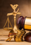 Judge gavel with money  and scales closeup Royalty Free Stock Images