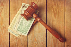 Judge gavel and money on wooden vintage background Royalty Free Stock Photos