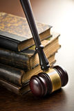 Judge gavel with old books. On wooden background Stock Photos