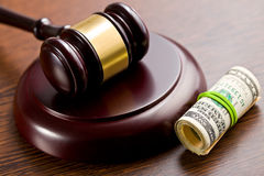 Judge gavel with pack of dollars Stock Images
