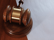 Judge gavel and paper sheet on wooden background. Royalty Free Stock Image