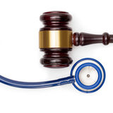 Judge gavel, pills bottle and stethoscope on white backround - studio shot Stock Photography