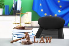 Judge gavel with scales and books Stock Photos