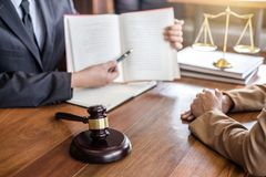 Judge gavel with scales of justice, Businesswoman and male lawyers or counselor discussing contract papers at law firm in office. Concepts of law stock photo