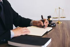 Judge gavel with scales of justice, male lawyers working having. At law firm in office. Concepts of law Stock Photo