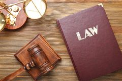Judge gavel with scales and Law book Royalty Free Stock Image