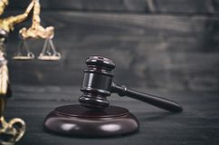 Judge Gavel, Scalesof Justice and Lady Justice on a black wooden royalty free stock photo