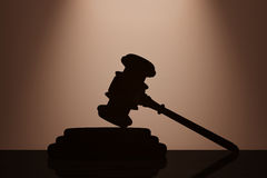 Judge Gavel and Sound Block with backlight over Wall. 3d Renderi Stock Image