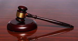 Judge gavel and sound board on the table Royalty Free Stock Photo