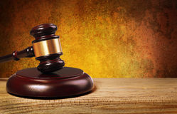 Judge gavel and soundboard over gold background Stock Photos