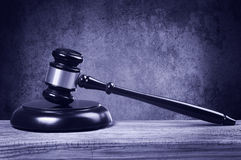 Judge gavel and soundboard on wooden table. Royalty Free Stock Photography