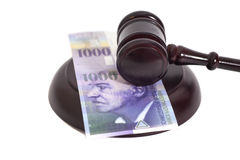 Judge Gavel and Swiss Thousand Franc Currency Royalty Free Stock Photos
