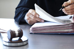 Judge with gavel on table Stock Image