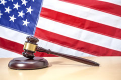 Judge gavel on table, USA flag. Symbol of justice Stock Photography