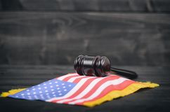 Judge Gavel and United States of America flag on a black wooden royalty free stock photography