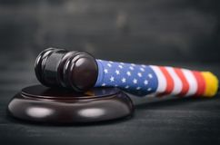 Judge Gavel and United States of America flag . Stock Photos