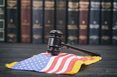 Judge Gavel and United States of America flag. Law and Justice, Legality concept, Law library, Judge Gavel and United States of America flag on a black wooden Royalty Free Stock Photo