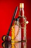 Judge gavel and whisky bottles Royalty Free Stock Photo