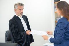 Judge giving paperwork verdict Royalty Free Stock Image