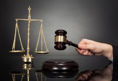 Judge with gravel and weight scale at desk Royalty Free Stock Photos
