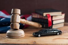 Free Judge Hammer And A Toy Car On A Wooden Table. Stock Photos - 109868533
