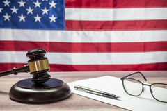 Judge Hammer and glasses on the background of USA flag Royalty Free Stock Image