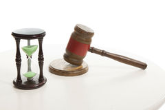 Judge  hammering and sand hourglass Stock Photography