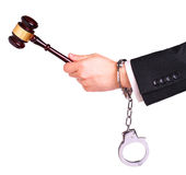 Judge hand with gavel in handcuffs isolated Royalty Free Stock Photo