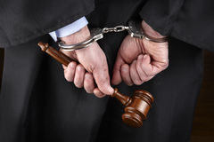 Judge in handcuffs Stock Image