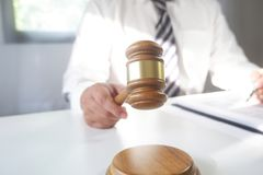 Judge hitting gavel and the report of the case with note paper on table, Law and justice concept stock photography