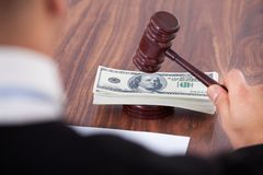 Judge hitting mallet on banknotes Stock Photos