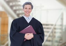 Judge holding book in front of staircase Stock Photo