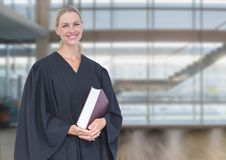 Judge holding book in front of windows royalty free stock photo