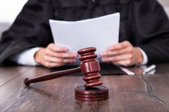 Judge holding documents Stock Image