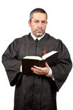 Judge holding the gavel and book Royalty Free Stock Photo