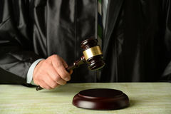 Judge Holding Gavel. Close up of judge holding gavel Royalty Free Stock Images