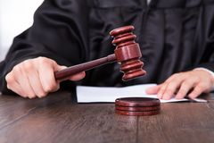 Free Judge Holding Mallet Stock Photo - 43870040