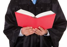 Judge holding statute book Royalty Free Stock Photos